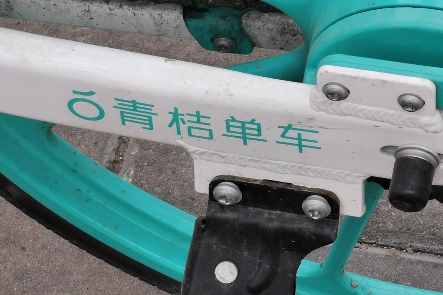 Didi green orange bicycle