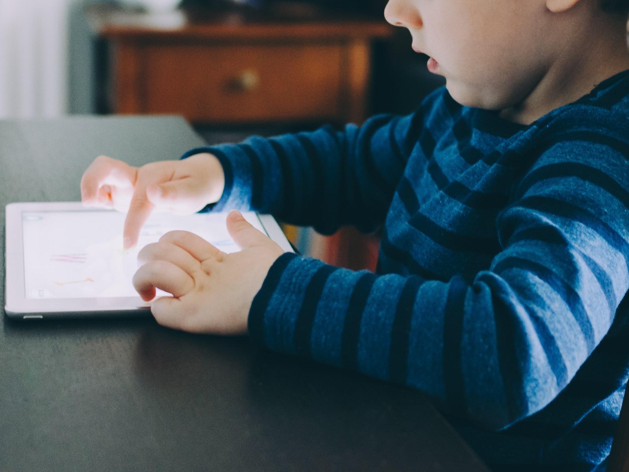 A child using an iPad. Kelly Sikkema/Unsplash