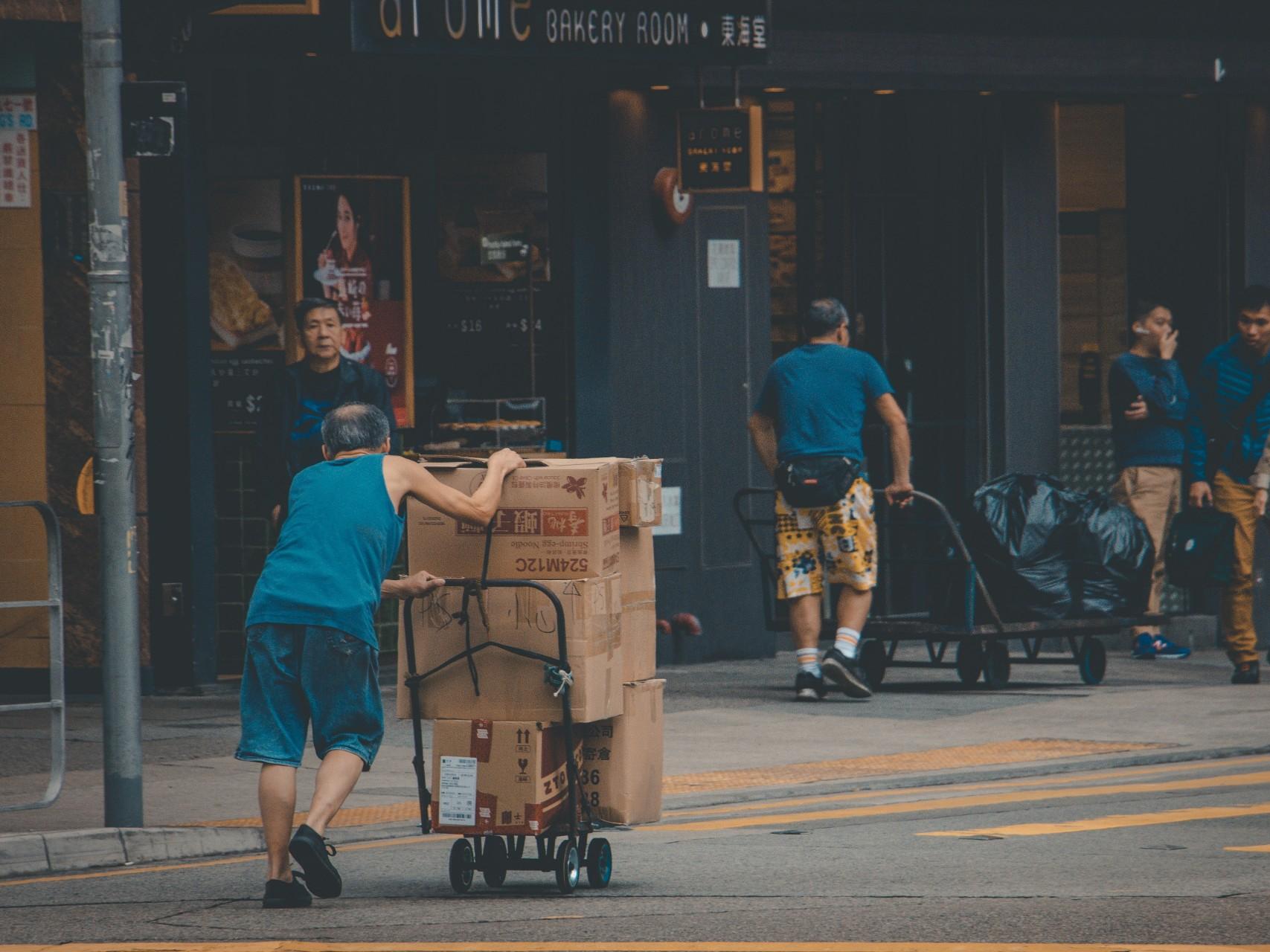 A man delivering boxes. Image Credit: Thomas Chan/Unsplash