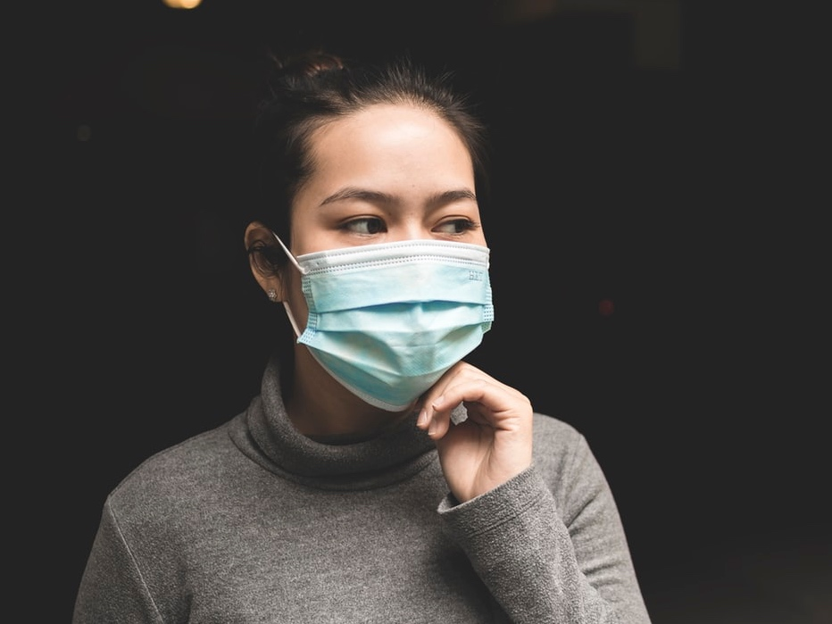 A lady in the mask is looking out. Image credit: Michael Amadeus/Unsplash