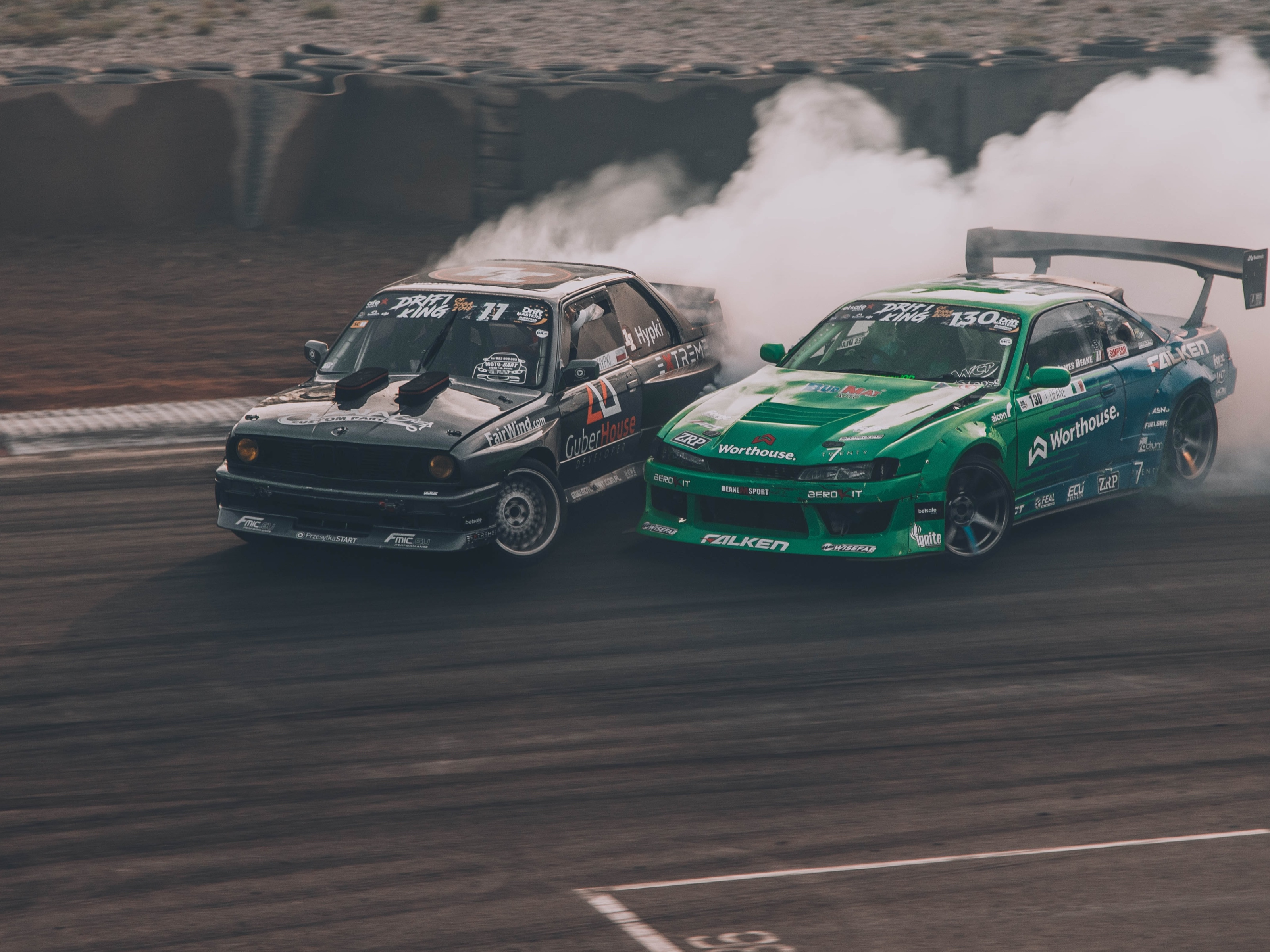 Two racing care are rushing to the finish line. Image credit: Ralph Blvmberg/Unsplash.