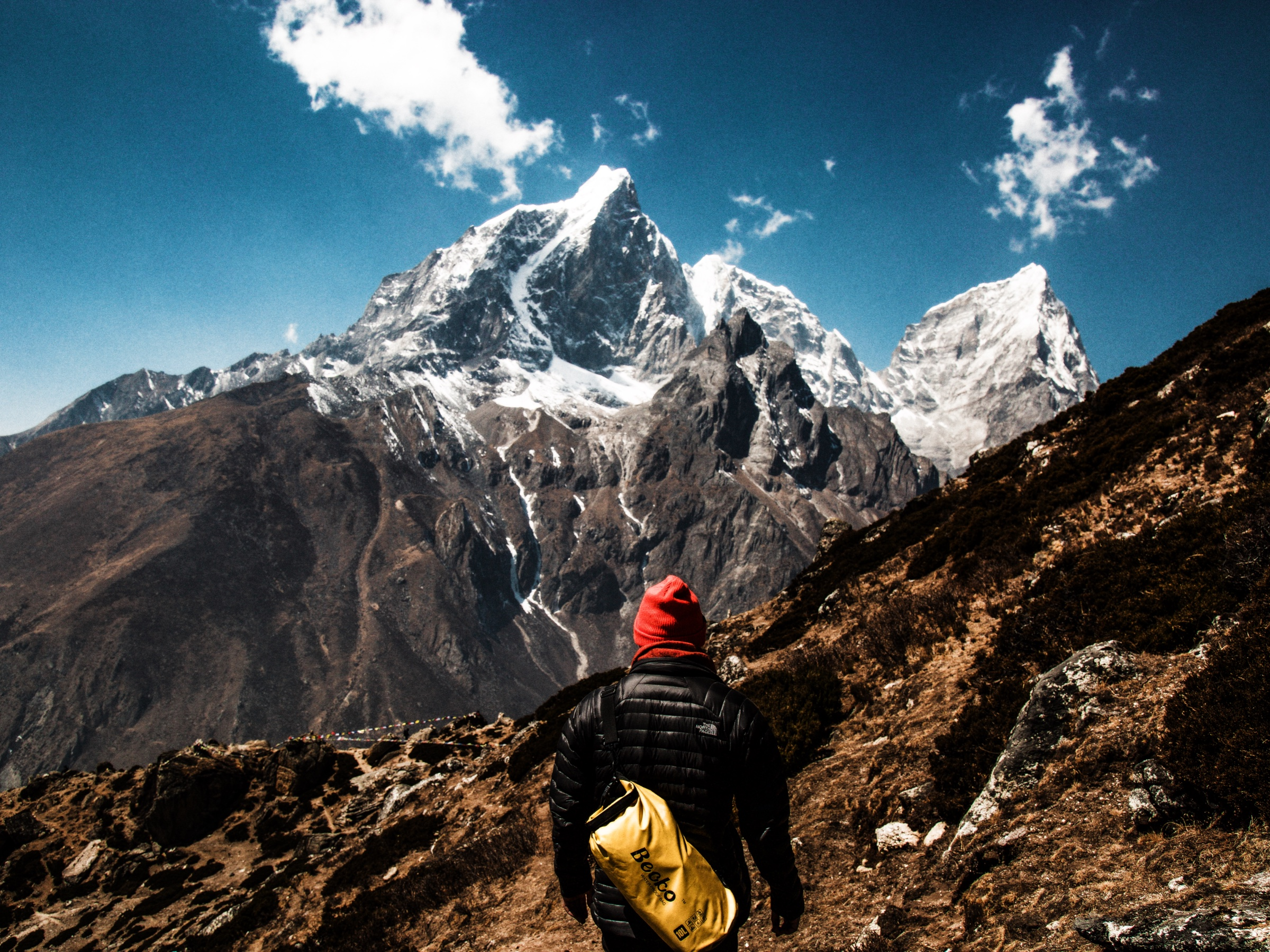 A milestone on the path to the Everest Mountains. Image credit: Christopher Burns / Unsplash